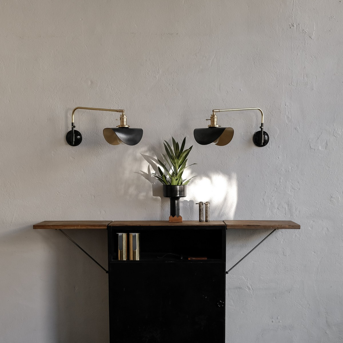 Pair of small brass swing wall lamp